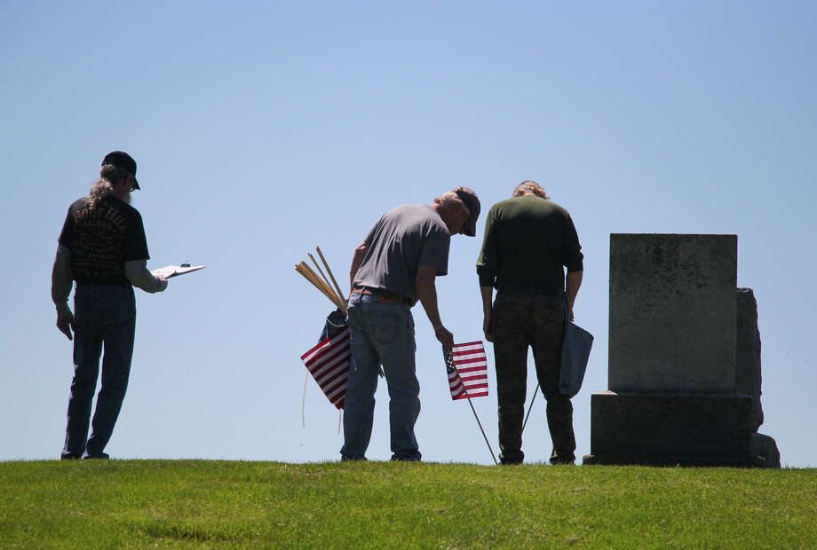 Veterans from American Legion Post No. 197 and VFW No. 9344 in Harbor Beach placed American flags at the graves of fellow veterans at Our Lake of Lake Huron, Rock Falls and Helena St, Anthony cemeteries on Thursday afternoon. Photo: Mark Birdsall/Huron Daily Tribune