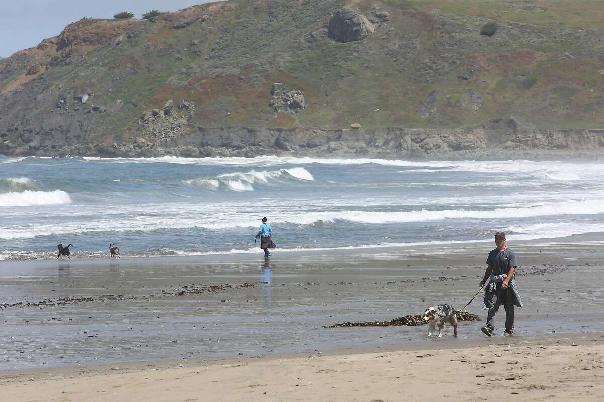 A man walks at Pacifica State Beach during a daily walk on Thursday, April 30, 2020 in Pacifica, Calif.