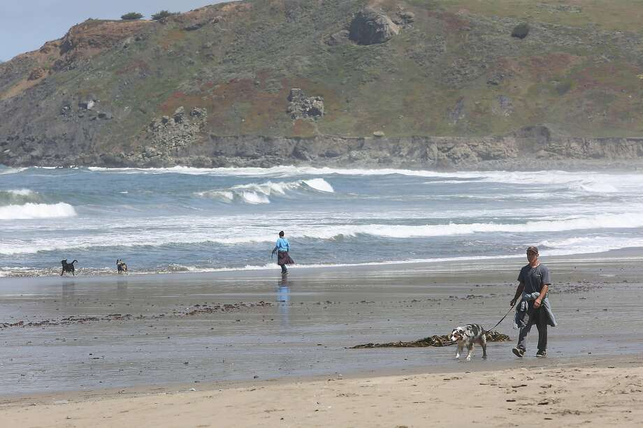 A man walksat Pacifica State Beach during a daily walk on Thursday, April 30, 2020 in Pacifica, Calif. Photo: Lea Suzuki, The Chronicle
