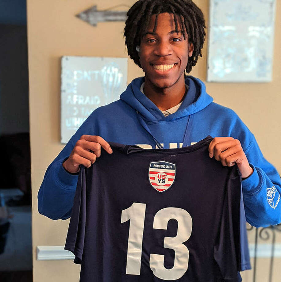RJ Parker displays his Missouri Olympic Development Team jersey. Parker will be a senior at Marquette Catholic High this fall. Under IHSA rules, he sat out last season after transferring from Trinity Catholic high in Florissant following his sophomore year, but remained with the team as manager. He earned the Missouri ODP spot in the ensuing off season. He was named a Southeast All-Star. Photo: Submitted Photo