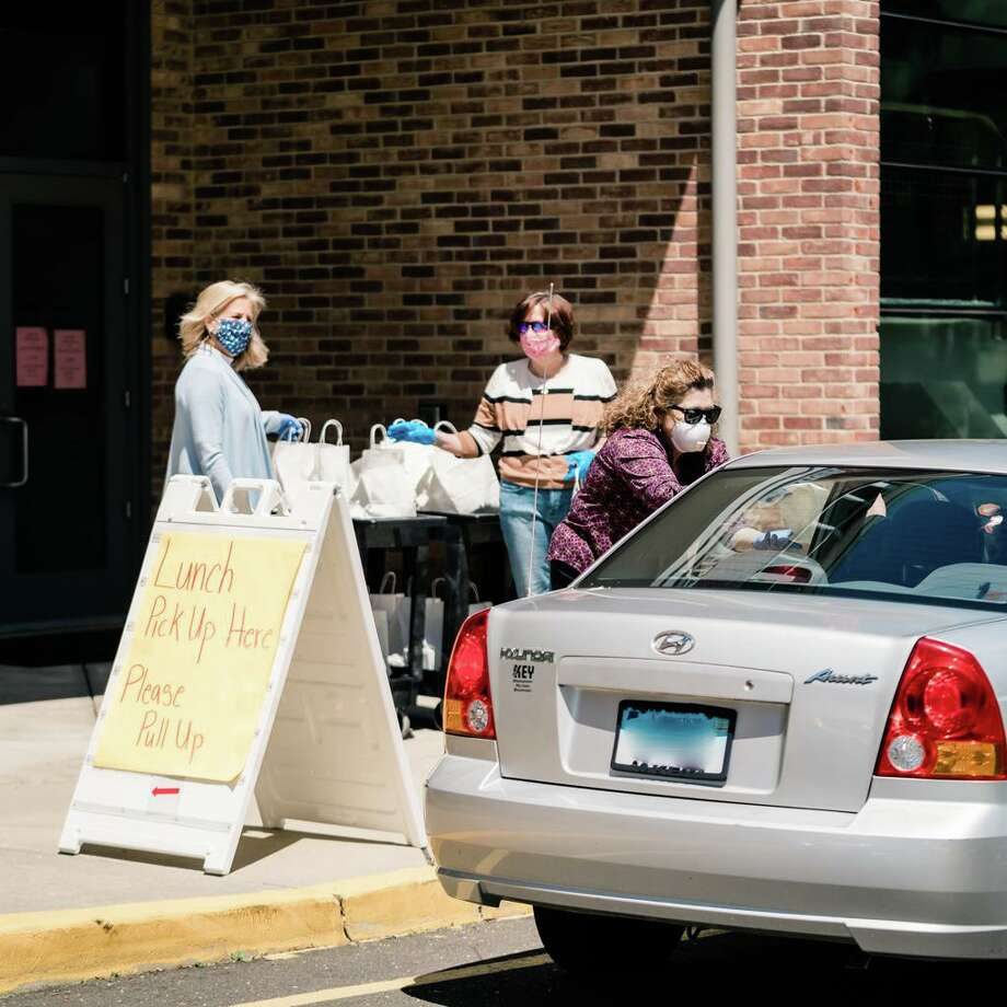 The Darien Senior Center and its members are grateful for the donated drive-through lunches throughout the pandemic. Photo: Calderwood Digitalhttps: / /calderwooddigital.com / /