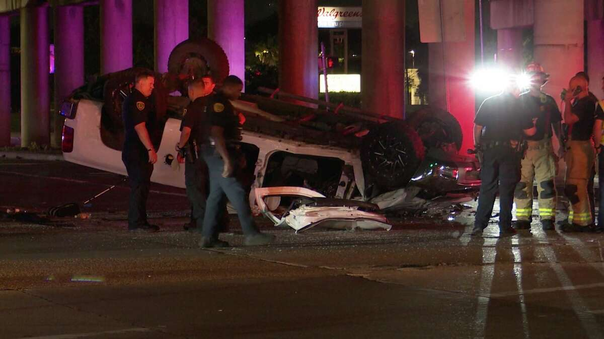 Houston police investigate after a pickup plunged off the North Freeway to avoid two street racers Thursday, May 21, 2020.