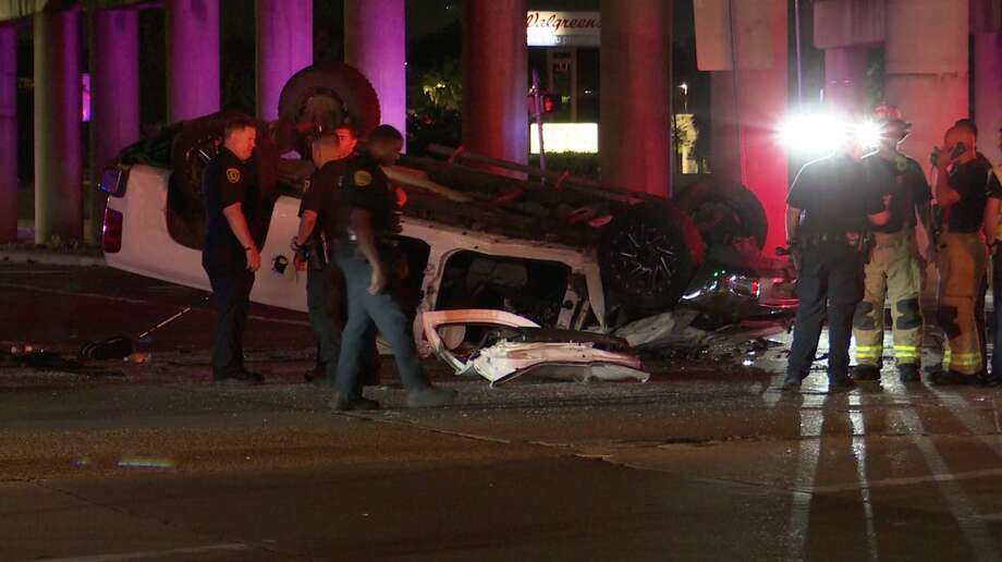 Houston police investigate after a pickup plunged off the North Freeway to avoid two street racers Thursday, May 21, 2020. Photo: OnScene.TV