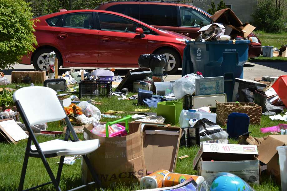 A family in Sanford, the Scherfs, clear out their wet basement and attempt to dry out their sentimental items like photos and music records out on their lawn on Thursday, May 21, 2020. (Ashley Schafer/Ashley.Schafer@hearstnp.com) Photo: Ashley Schafer