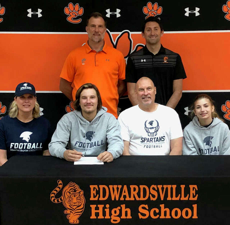 Edwardsville High School senior Nick Hylla, seated left center, will play college football next year at Missouri Baptist University. He is joined by his family and EHS coach Matt Martin and assistant coach Alec Oller. Photo: For The Intelligencer