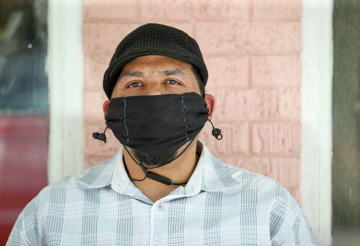 Roy Acosta poses while wearing a mask Thursday, May 21, 2020, along 19th Street in the Heights neighborhood in Houston. He said his daughter gave him the mask as a gift three weeks ago, and that he has been wearing it ever since.