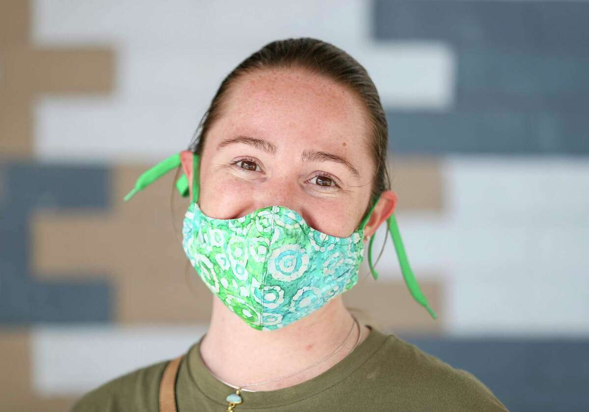 Emily Deatherage poses while wearing a mask Thursday, May 21, 2020, along 19th Street in the Heights neighborhood in Houston. She said her mom's friend made it, and that she has worn it since March 10.