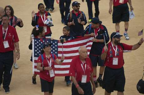 US delegation parades during the opening ceremony of the XXI World Transplant Games 2017 in Malaga on June 25, 2017. To be eligible to compete the competitors from 55 countries must have had either a kidney, heart, lung, intestine, pancreas or bone marrow transplant. / AFP PHOTO / JORGE GUERRERO (Photo credit should read JORGE GUERRERO/AFP via Getty Images)
