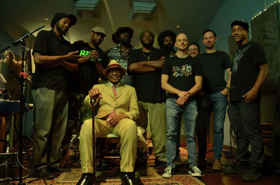 "Legendary saxaphonist Archie Shepp, seated, collaborated with his nephew Raw Poetic, second from left, and a team of D.C. musicians on ""Ocean Bridges."" Photo: Earl Davis / Earl Davis"