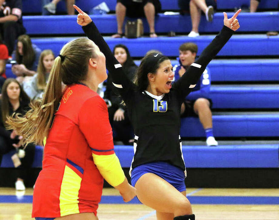 Roxana libero Makenzie Keller (right) celebrates a point with teammate Jacey Trask during a a Roxana Tourney match last season. Shells volleyball, and the rest of Roxana's sports stable, will begin competition as a member of the Cahokia Conference beginning in 2022-23. Photo: Greg Shashack | The Telegraph