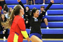 Roxana libero Makenzie Keller (right) celebrates a point with teammate Jacey Trask during a a Roxana Tourney match last season. Shells volleyball, and the rest of Roxana's sports stable, will begin competition as a member of the Cahokia Conference beginning in 2022-23.