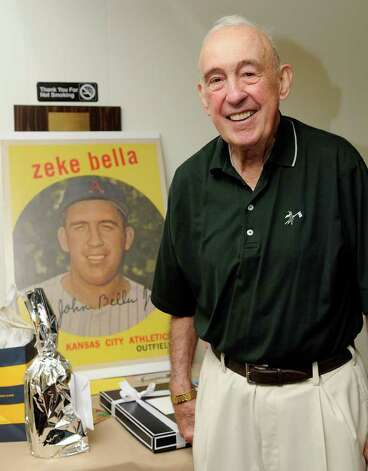 "John ""Zeke"" Bella, former outfielder for the New York Yankees and Kansas City Athletics, stands in front of a replica of his baseball card. Bella celebrates his 80th birthday with friends and family at the St. Lawrence Club in Cos Cob, CT on Sunday August 22, 2010. Photo: Shelley Cryan / Shelley Cryan Freelance"