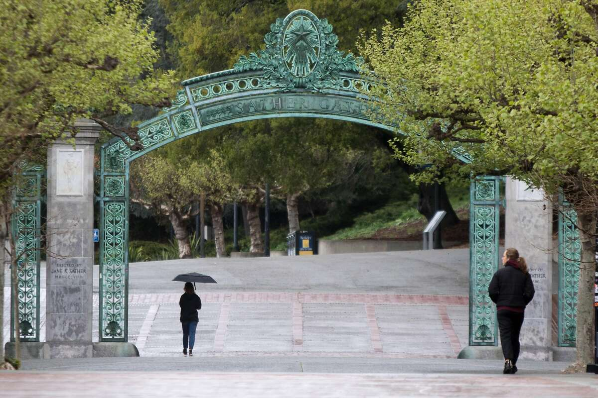 FILE -- People walk on the empty UC Berkeley campus during the coronavirus shelter-in-place order in Berkeley, Calif. on March 25, 2020.