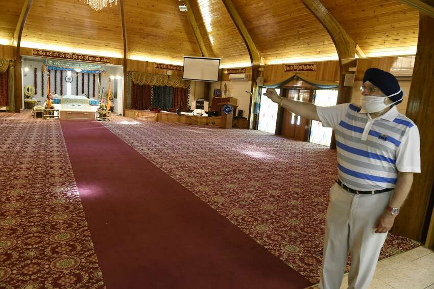 Dr. Paul Uppal stands in the Gurdwara where people will be social distancing at least six feet apart when they hold services again at the Sikh Temple on Wednesday, May 20, 2020 in Niskayuna, N.Y.