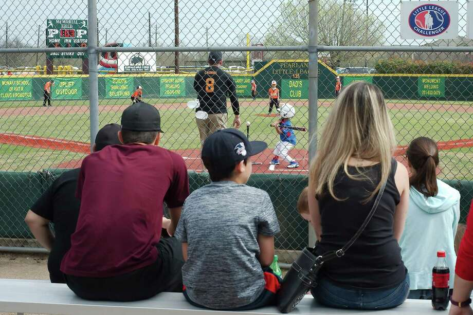 The crack of the bat and cheers of the crowd won't be heard this year in Pearland Little League, which decided to cancel its 2020 season, citing concerns for health and safety during the novel coronavirus pandemic. Photo: Kirk Sides / Houston Chronicle / © 2018 Kirk Sides / Houston Chronicle