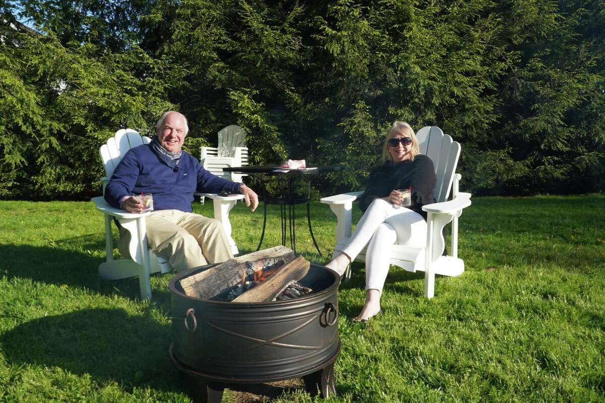 James and Maureen O'Hora were sitting by a fire pit at the Roger Sherman Inn in New Canaan recently. This is one example of how businesses are using ingenuity to reopen while staying within Connecticut Gov. Ned Lamont's directives during the coronavirus pandemic.