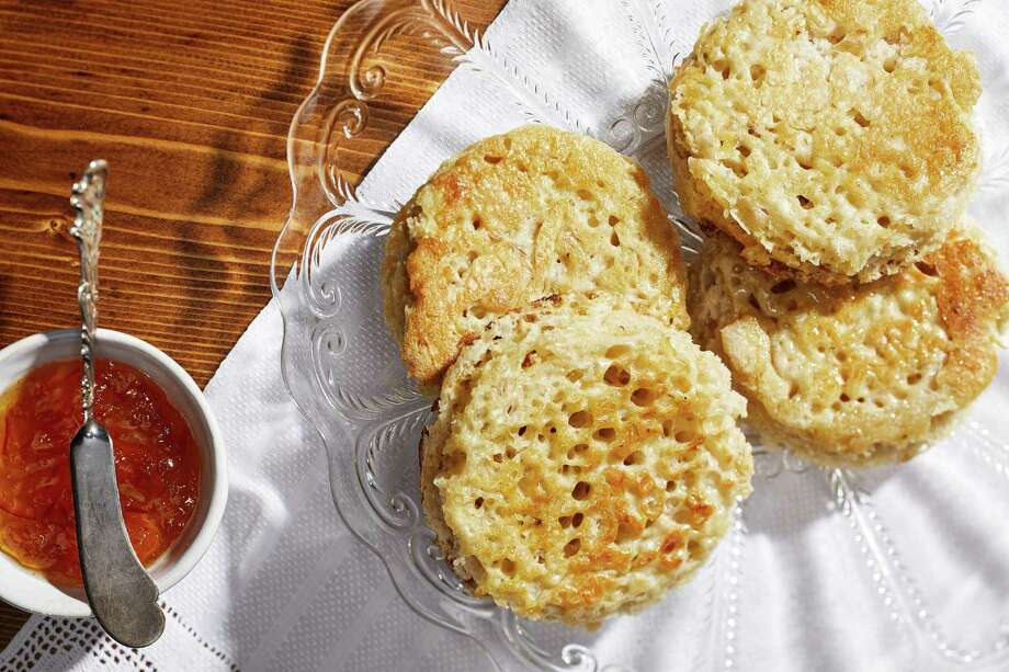 Sourdough Crumpets. Photo: Photo By Tom McCorkle For The Washington Post. / For The Washington Post