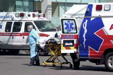AMR medics bring a patient into the emergency room at Yale New Haven Hospital in New Haven.