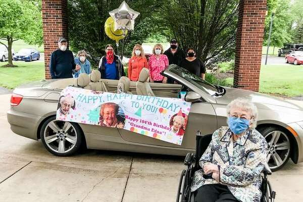 Edna Griesbaum with a surprise celebration for her 104th birthday Wednesdsay at Asbury Village Godfrey. With her are, from left, Art and Jo Greenwood, RuthAnn Meyer, Maryann Kelley, Holly Rain and Tad and Amy Holt.