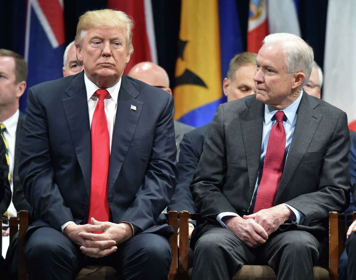 FILE - In this file photo taken on December 15, 2017, US President Donald Trump (L) sits with Attorney General Jeff Sessions in Quantico, Virginia, before participating in the FBI National Academy graduation ceremony.