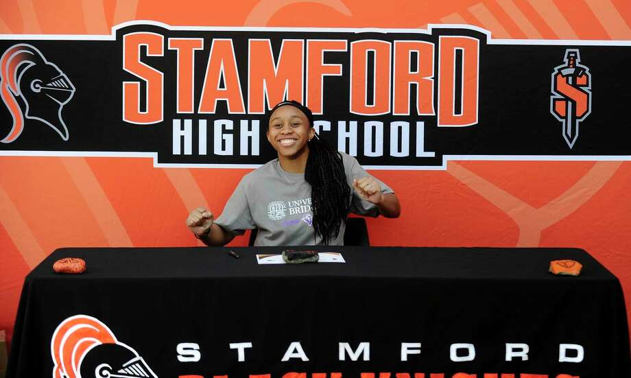 Senior Jessica Nelson does an impromptu dance as she prepares to sign her commitment to play basketball at the University of Bridgeport. Photo: Matthew Brown / Hearst Connecticut Media / Stamford Advocate
