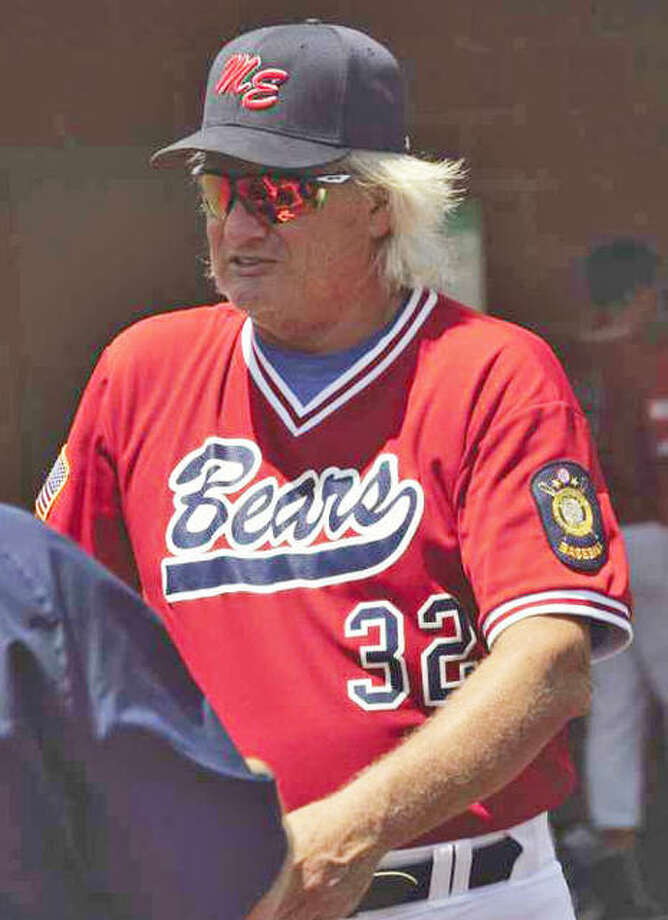 Former Edwardsville Post 199 manager Ken Schaake watches the action from the dugout. Photo: Intelligencer File Photos
