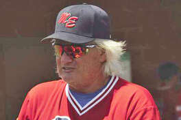 Former Edwardsville Post 199 manager Ken Schaake watches the action from the dugout.