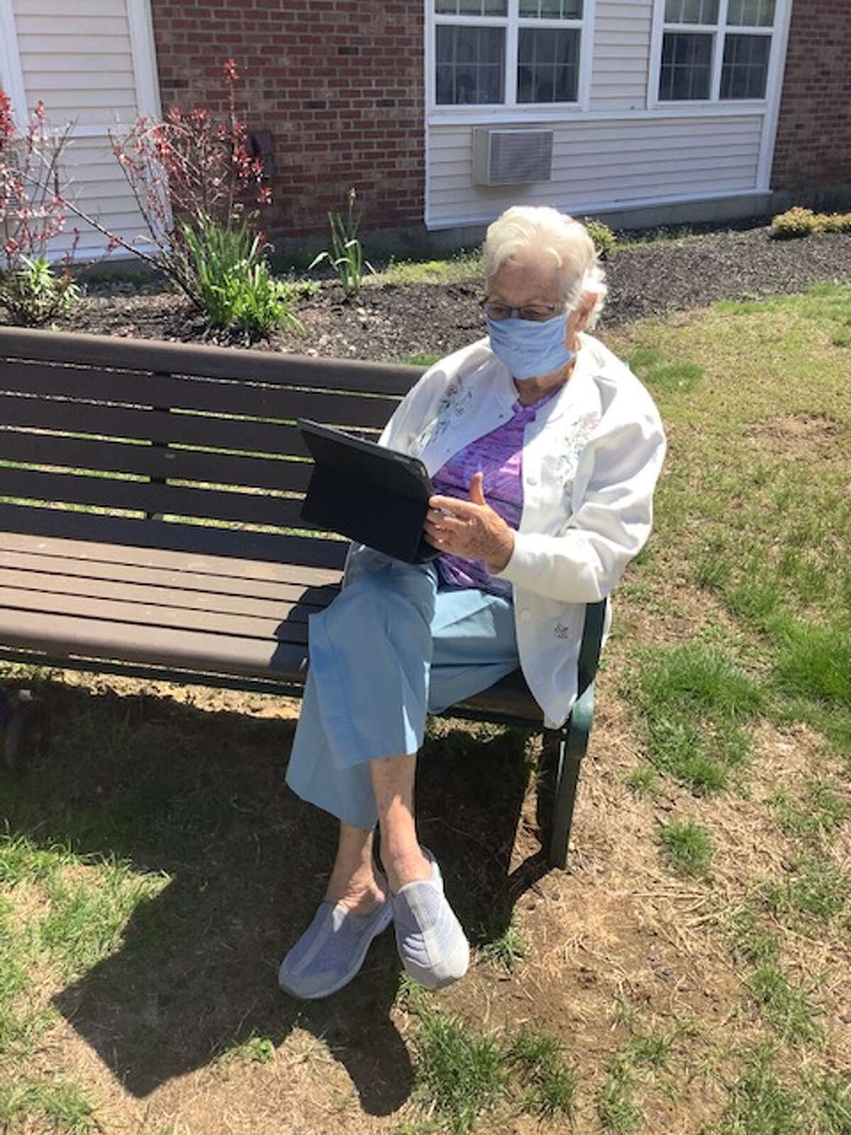 Glenmont's Ruth Pupke on her e-reader, a tool she learned to use well before the coronavirus pandemic.