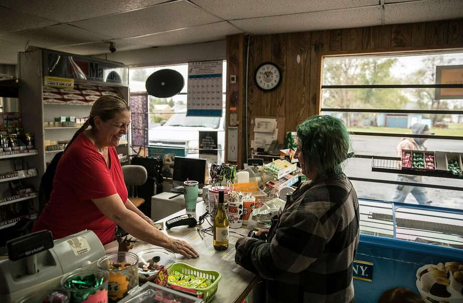 Leah Ross, left, helps customer Megan Collins in her store in Tulelake, Calif., on Monday, May 18, 2020. Ross fears that another downturn in agriculture in the regions will further hurt the town. Nowhere has California�s dry winter hit harder than the state�s far north, where hundreds of farmers along the Oregon border now risk having their irrigation water shut off and their crops destroyed. The Klamath Project, which ships water from the High Cascades to more than 200,000 acres of onions, potatoes, wheat and barley across two states, is running low. Water districts supplied by the project say there may not be water for farms after next month. The last time the water agencies of the Klamath Basin warned of such a dire situation, farmers marched on the gates of the project in protest and U.S. marshals were called in to keep the peace. Today, the prospect of running out of water comes as the farm-dependent region faces the additional economic blow of the coronavirus pandemic. Photo: Carlos Avila Gonzalez / The Chronicle