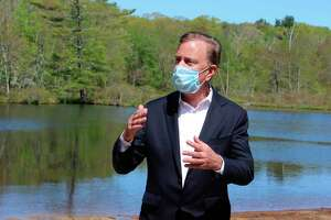 Gov. Ned Lamont, shown here in a 2020 file photo, announced Friday that after a record number of visitors to state parks and forests last year, capacity limits will rise, picnic tables will be allowed and freshwater swimming will resume in places such as Indian Well State Park in Shelton and Squantz Pond in New Fairfield.
