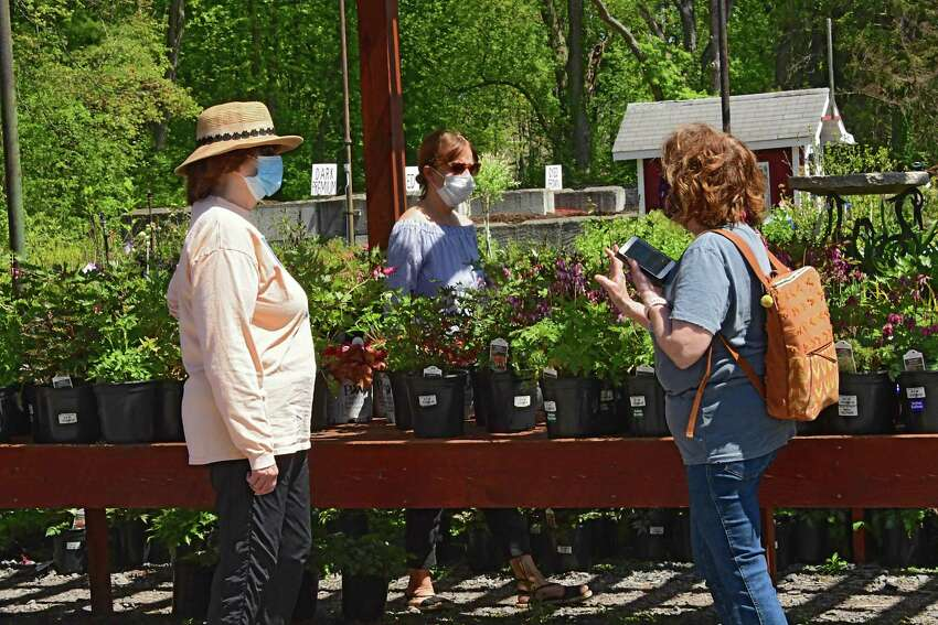People are seen social distancing while they shop at The Gade Farm Friday, May 22, 2020 in Guilderland, N.Y. People were buying plants and flowers to plant over the Memorial Day weekend. (Lori Van Buren/Times Union)