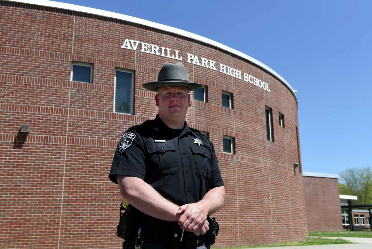 """Rensselaer County sheriff's deputy Brian Nikles, is pictured outside Averill Park High School, where he serves as a school resource officer on Friday, May, 22, 2020, in Averill Park, N.Y. Nikels has been a major part of the school's food distribution program since its first day of closure, serving food to all Averill Park students in need. """"It brings back some normalcy for the students,"""" he said. """"I'm a familiar face. That's why they asked me to be a part of this distribution."""" His job as a sheriff has enabled him to aid families who can't get to the school.""""I'll bring a meal down to a family. They need help delivering to a couple places, so I have no problem, while I'm out doing my job, helping out with that.""""The road trips have included home visits, accompanied by a principal or other school official, to check in on students who have had trouble connecting to their school work or engaging in at-home instruction. Read the storyIf you know a hero, let us know here. (Will Waldron/Times Union)"""