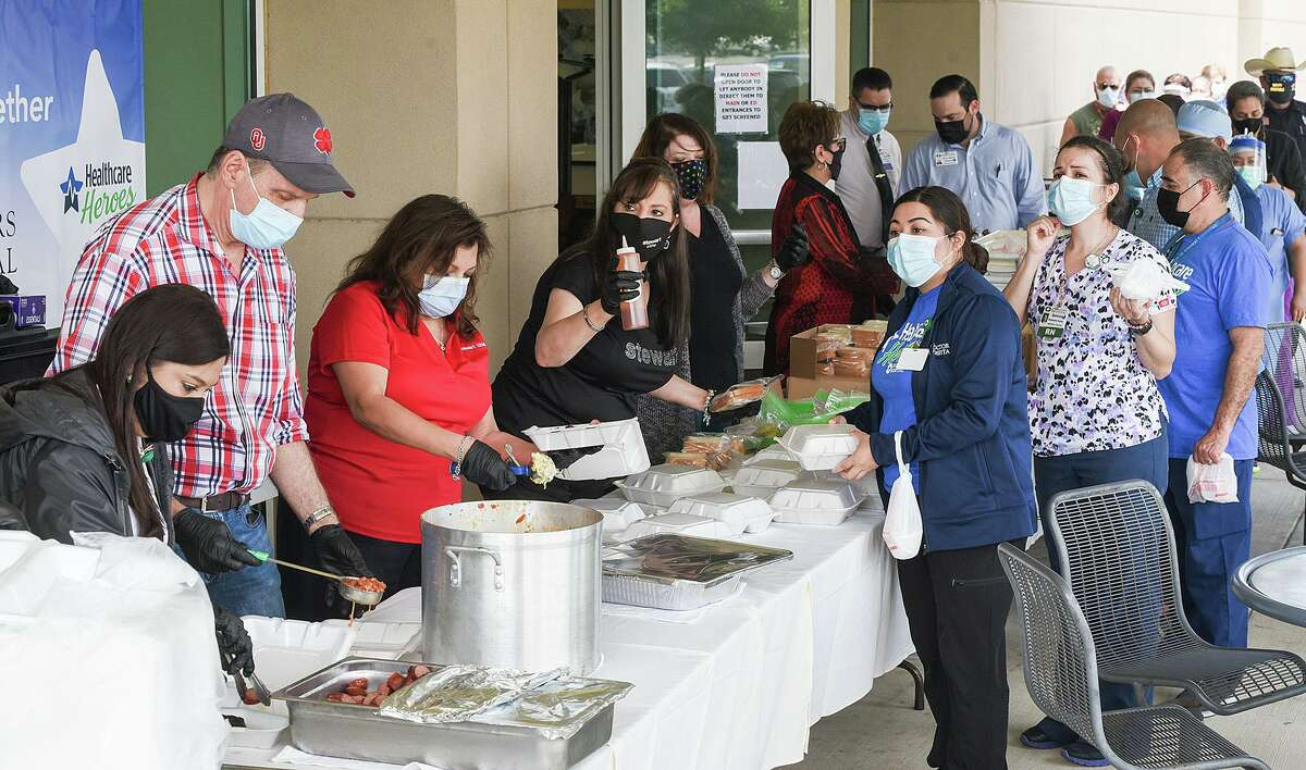 The Emergency Assistance Team, or EAT organization, together with local realtors and restaurants, helped provide lunch for first responders and front-line workers, Thursday, May 21, 2020, at Doctors Hospital as part of the support for Healthcare Heroes.