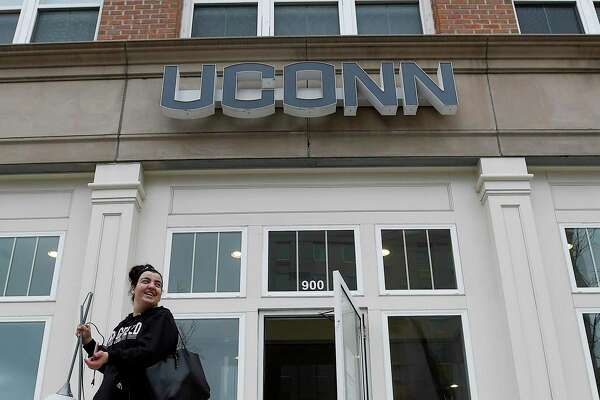 Julianna Russo of Wilton, a student at UCONN Stamford, carries some of her belongings as she vacates the student housing in UCONN Stamford's Residential Life building on March 25, 2020 in Stamford, Connecticut. Universities across the state, having moved classes on line and sent students home due to the coronavirus, are in the process of figuring out a plan to reconcile with parents and students over room and board payments.