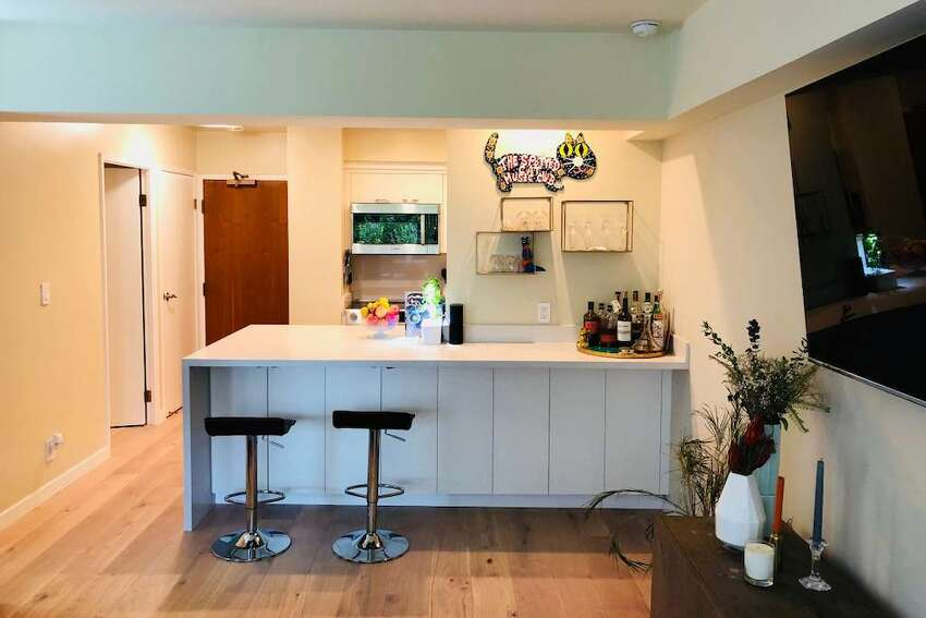 The renovations include new hardwood floors, a new kitchen, a new bathroom vanity area and storage.