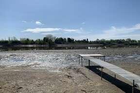 Post-flood images of Wixom Lake area on Oakridge Drive, May 22, 2020