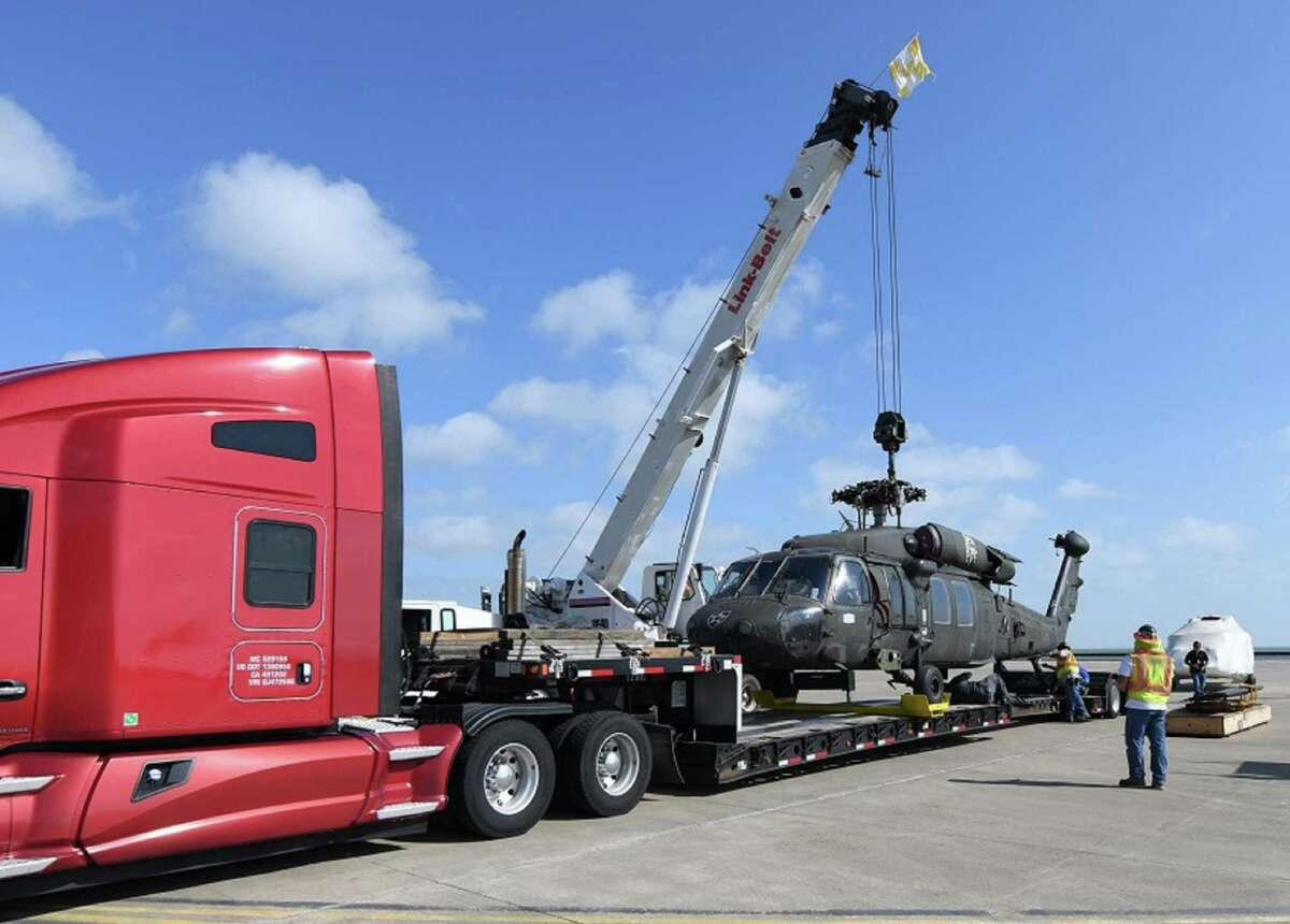 A Sikorsky Black Hawk helicopter is loaded at Corpus Christi Army Depot in Texas for transport to Wichita State University, where researchers at the National Institute of Aviation Research will create a virtual model of the work horse of U.S. Army aviation.