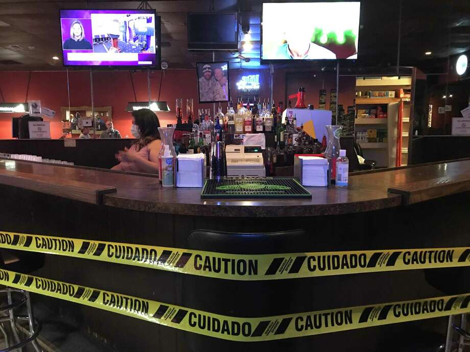 Although the actual bar is closed, Thirsty's welcomed a few regulars back on May 22 after an extended pandemic-related shutdown. Temperature checks are required in the wake of the coronavirus pandemic. Photo: Kim Brent / Beaumont Enterprise / Beaumont Enterprise