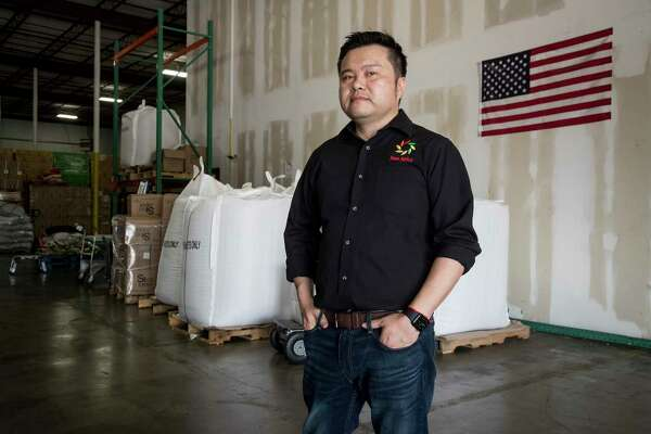 "Jason Jing, president of Hao Spice, stands in his spice company's warehouse on Friday, May 22, 2020 in Sugar Land. Jing's company has been hit hard by the trade war with China. Texas Republicans are going all in on China, calling for a ""fundamental rethinking"" of the U.S. relationship with the nation they say dropped a ""biological bomb"" on the world with the coronavirus outbreak. It's rhetoric that will only increase as the November election gets closer, as Senate Republicans' official political playbook calls for focusing on China to take the heat off the Trump administration."