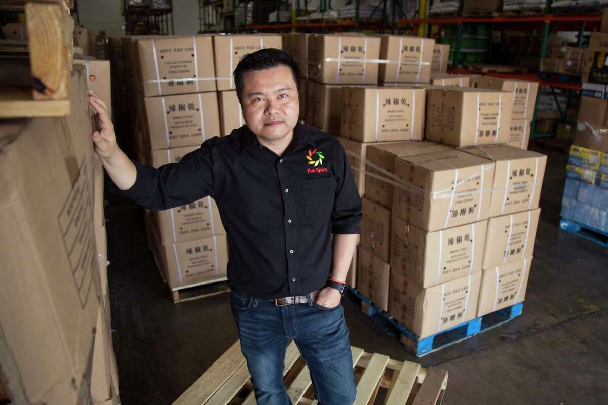 Jason Jing, president of Hao Spice, stands in his spice company's warehouse on Friday, May 22, 2020 in Sugar Land. Jing's company has been hit hard by the trade war with China. Texas Republicans are going all in on China, calling for a