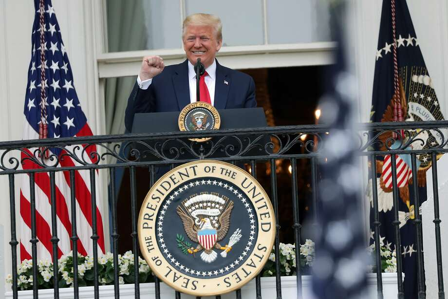 WASHINGTON, DC - MAY 22: U.S. President Donald Trump speaks from the Truman Balcony during a Rolling to Remember Ceremony: Honoring Our Nations Veterans and POW/MIA at the White House May 22, 2020 in Washington, DC. President Trump hosted the event to honor Americas veterans and fallen heroes. (Photo by Alex Wong/Getty Images) Photo: Alex Wong, Getty Images