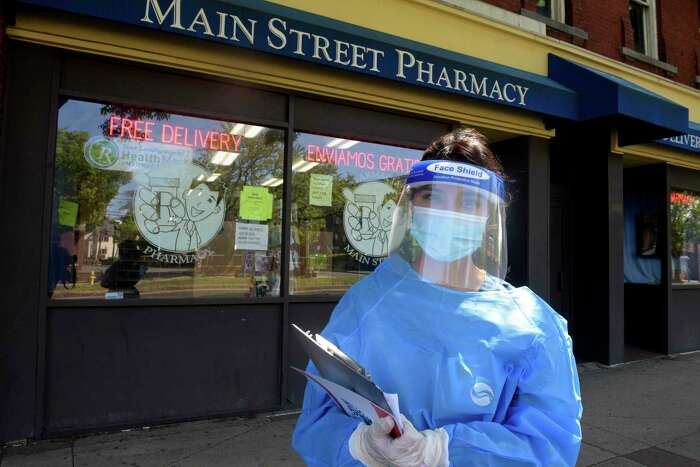 Pharmacy Technician Sabrina Salguero with a self administered coronavirus test at Main Street Pharmacy. The pharmacy is now offering the tests. Friday, May 22, 2020, in Danbury, Conn.
