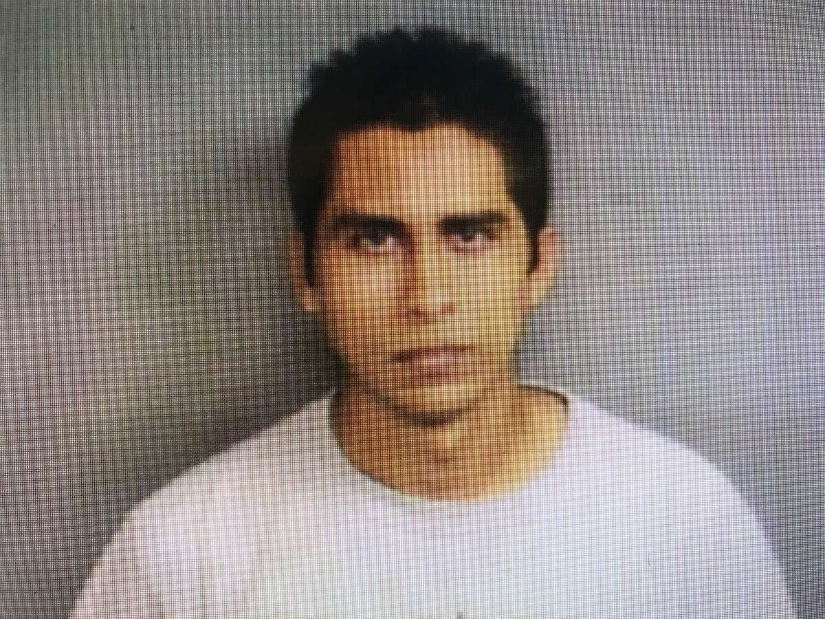 A Stamford police mug shot of Cesar Olvia from 2012 when he at age 23, was charged with having sex with a 14-year-old girl.