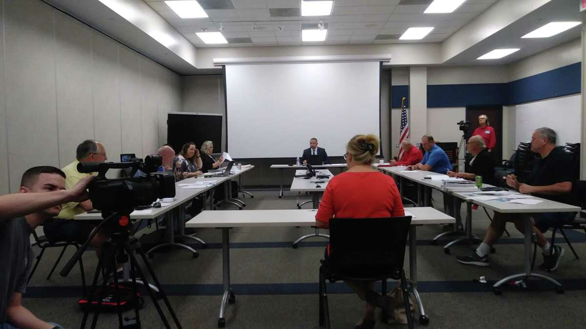 During a previous meeting of Harris County Emergency Services District No. 11 from before the pandemic, the board confronted Wren Nealy with Cypress Creek EMS about issues with CCEMS and funds.