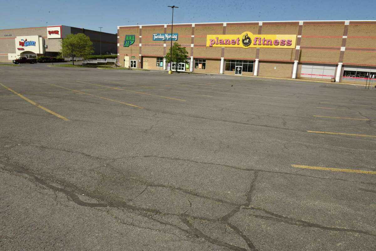 Empty parking lots are seen outside gyms and other businesses due to COVID-19 at Crossgates Commons on Friday, May 22, 2020 in Guilderland, N.Y. (Lori Van Buren/Times Union)