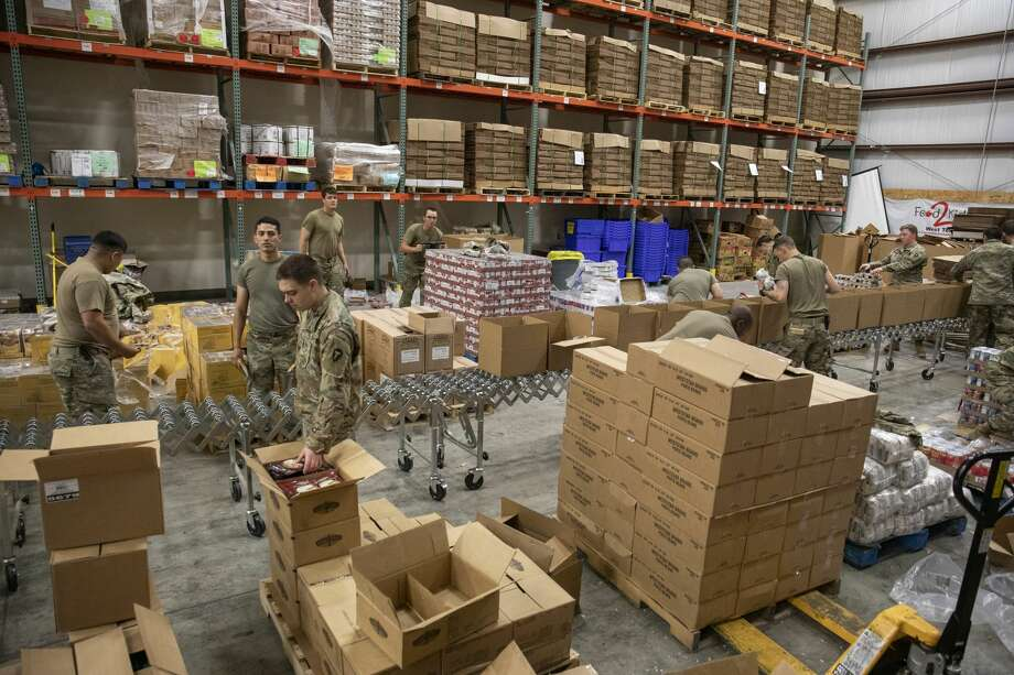 Members of the Texas Army National Guard build pantry boxes Tuesday, May 19, 2020 at the West Texas Food Bank in Odessa. Jacy Lewis/Reporter-Telegram Photo: Jacy Lewis/Reporter-Telegram