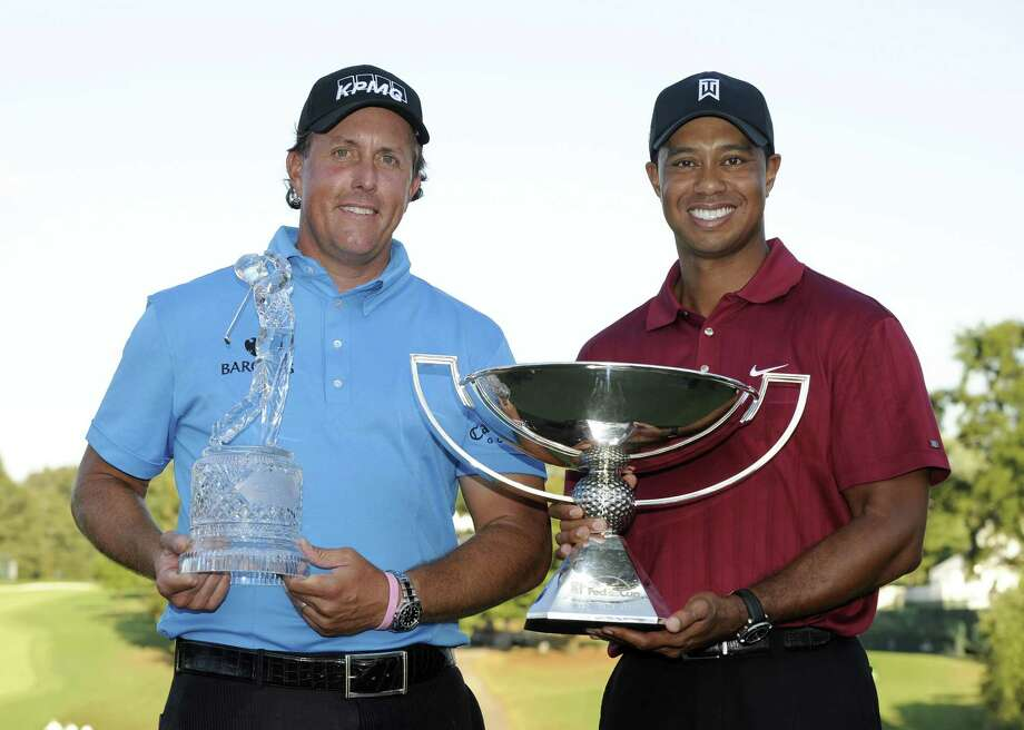 "50 memorable Tiger Woods and Phil Mickelson victories Capital One's ""The Match: Champions for Charity"" kicks off at 3 p.m. EST Sunday, May 24, on TNT, TBS, truTV, HLN, HLN in Canada, and CNN International. The team pro-am features duos of Tiger Woods and Peyton Manning against Phil Mickelson and Tom Brady—each mic'd up for optimal viewer access to all the chatter and trash-talk. Contested at Medalist Golf Club in Hobe Sound, Florida, the first nine holes are Four-Ball (Best Ball) format, and the back nine are Modified Alternate Shot. This rare COVID-19 sports distraction also carries the obvious intent of financial goodwill, so along the way, ""there will also be a set of on-course challenges to raise additional charitable funds,"" per the PGA Tour. Also nicknamed Tiger vs. Phil: The Match II, this is the illustrious pair's second head-to-head match play event; though the first, which Lefty won as a slight underdog on Nov. 23, 2018, was a winner-take-all $9 million prize and was broadcast as a pay-per-view. Mickelson and Brady are +160 underdogs this time, while Woods and Mannings are the -200 favorites. To get viewers prepped for this cross-sport charity event with four undeniable legends, Stacker presents a retrospective gallery of Tiger and Phil's most memorable career victories. With 20 combined major wins (Tiger's 15, Phil's five) and an inconceivable 126 total PGA Tour titles (82 and 44 respectively), we curated this list with only 50 of the best based on prestigiousness, postseason implications, and fabled... Photo: Stan Badz // Getty Images"