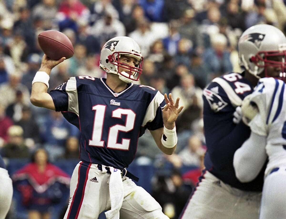 FILE - In this Sept. 30, 2001 file photo, New England Patriots quarterback Tom Brady (12) passes during Brady's first start of an NFL football game against the Indianapolis Colts in Foxborough, Mass.