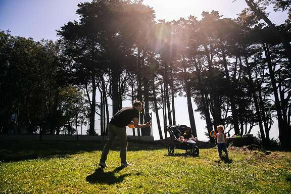 Michael Stein, left, plays catch with son Wyatt at Holly Park, amid the coronavirus disease (COVID-19) outbreak, in San Francisco, Calif. on Thursday, May 21, 2020.