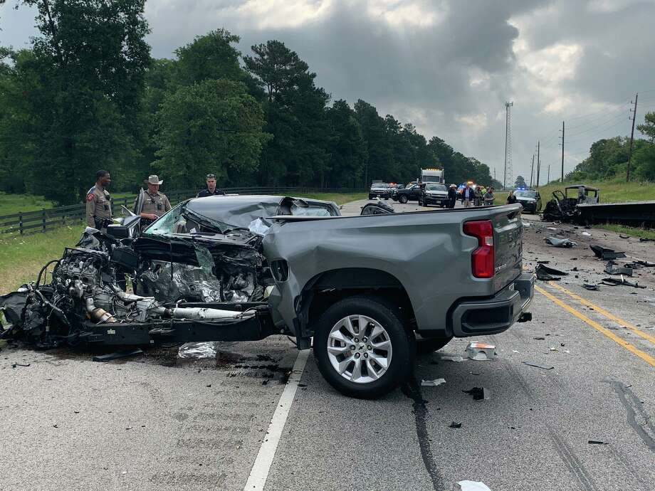 A pickup truck is seen Wednesday morning on Texas 105 in the city of Montgomery after it and a tractor-trailer crashed head-on. Photo: Courtesy Of The Texas Department Of Public Safety